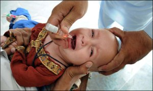 a baby being administered the life saving anti-polio drop